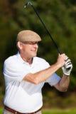 играть шарика ударенный гольфом Стоковые Фото