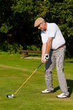 играть шарика ударенный гольфом Стоковое фото RF