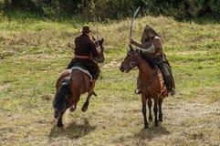 играющая Рол игра воссоздает сражения Монгол-татарского хомута в зоне Kaluga России 10-ого сентября 2016 стоковое изображение