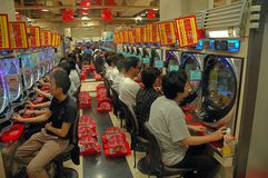 Играя в азартные игры наркоманы Стоковые Изображения RF