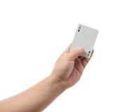 Играя карточки в руке изолированной на белой предпосылке Стоковое Изображение RF