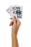 Играя карточки в руке изолированной на белой предпосылке стоковые фотографии rf