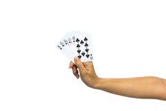 Играя карточки в руке изолированной на белой предпосылке Стоковое фото RF