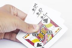 Играя карточки в руке изолированной на белой предпосылке Стоковые Изображения RF