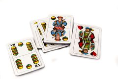 Играя карточки на белой предпосылке, конце вверх Стоковое Изображение