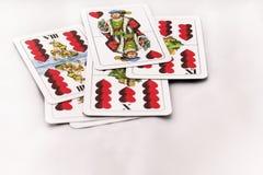 Играя карточки на белой предпосылке, конце вверх Стоковые Фотографии RF