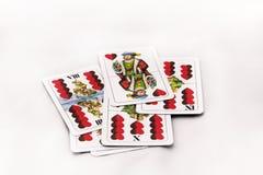 Играя карточки на белой предпосылке, конце вверх Стоковые Изображения