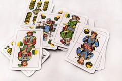 Играя карточки на белой предпосылке, конце вверх Стоковые Фото