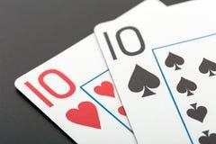 2 играя карточки на сером цвете Стоковая Фотография