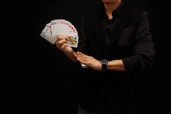 Играя карточки, один вентилятор руки стоковое фото