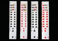 Играя карточки распространили вне на черной предпосылке Стоковое фото RF