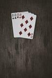 Играя карточки 4 eights на деревянном столе Стоковое Изображение