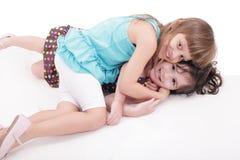 Игра 2 детей совместно Стоковое Фото