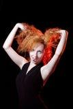 Игра женщины Redhead дурачок стоковые фото