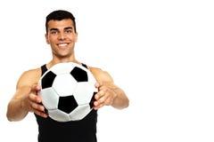 Игра молодого человека с шариком Стоковые Фото
