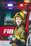 Игра пожарного ребенка Стоковые Изображения RF
