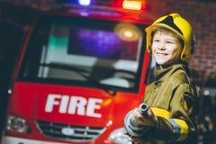 Игра пожарного ребенка Стоковые Фотографии RF
