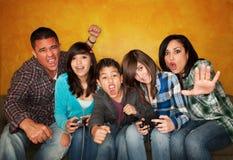 игра семьи играя видео Стоковое Изображение RF
