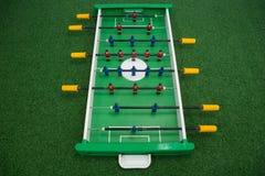 Игра футбола таблицы на искусственной траве Стоковая Фотография RF