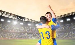 Игроки празднуют цель стоковое фото