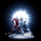 Игроки хоккея на льде катаются на коньках на абстрактной предпосылке стоковая фотография