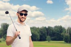 Игрок в гольф на поле для гольфа Стоковое фото RF