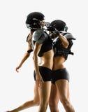 Игрок женщины американского футбола в действии стоковая фотография rf