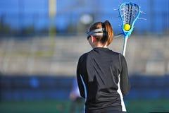 игрок lacrosse девушки шарика Стоковые Изображения