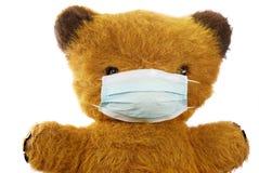 игрушечный маски гриппа медведя Стоковая Фотография