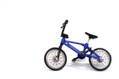 Игрушка велосипеда на белой предпосылке Стоковое фото RF