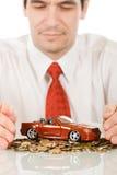 игрушка красного цвета автомобиля бизнесмена Стоковое Изображение RF