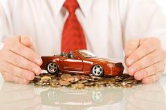 игрушка красного цвета автомобиля бизнесмена Стоковое Фото
