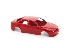 игрушка красного цвета автомобиля тела Стоковые Фотографии RF