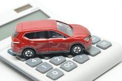 игрушка красного цвета автомобиля чалькулятора Стоковое Изображение