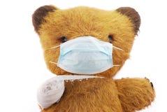 игрушка маски гриппа медведя мягкая Стоковые Изображения RF