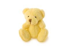 Игрушка плюшевого медвежонка мягкая сидя на белой предпосылке Стоковые Фото