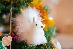 Игрушка рождества белки на дереве Стоковые Изображения