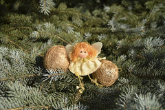 Игрушка рождества в форме ангела и сфер золота Стоковое фото RF