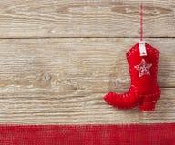 Игрушка рождества ковбоя на деревянной предпосылке Стоковая Фотография