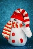 Игрушка снеговика на голубой предпосылке Стоковое Изображение RF