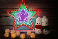 Игрушка снеговика на деревянной предпосылке Стоковая Фотография RF