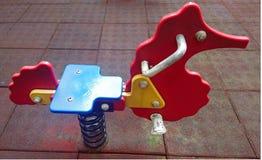 Игрушка спортивной площадки детей стоковое фото rf