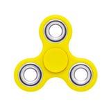 Игрушка стресса желтого цвета обтекателя втулки пальца непоседы анти- изолированная на белизне Стоковое фото RF