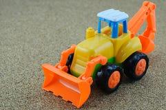 Игрушка backhoe трактора стоковая фотография