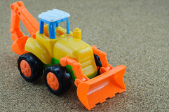 Игрушка backhoe трактора стоковые изображения rf