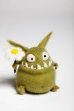 Игрушка Mosters Felted с цветком Стоковое Изображение