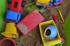 Игрушки в ящике с песком Стоковые Изображения RF