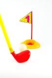 Игрушки гольфа на белизне и владении одно стоковые фотографии rf