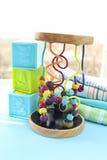 Игрушки и одежды младенца Стоковое фото RF