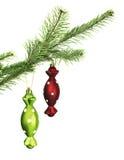 2 игрушки конфеты на ветви хвои Стоковое Изображение RF